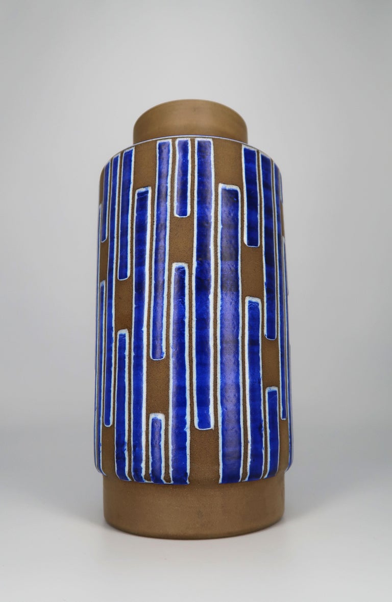 Graphically stunning hand decorated Danish Mid-Century Modern lustrous cobalt blue, chalk white and raw ceramic vase from the 1960s. Manufactured in northern Zealand by Schollert Keramik. Thick bright cobalt blue asymmetrical stripes with white