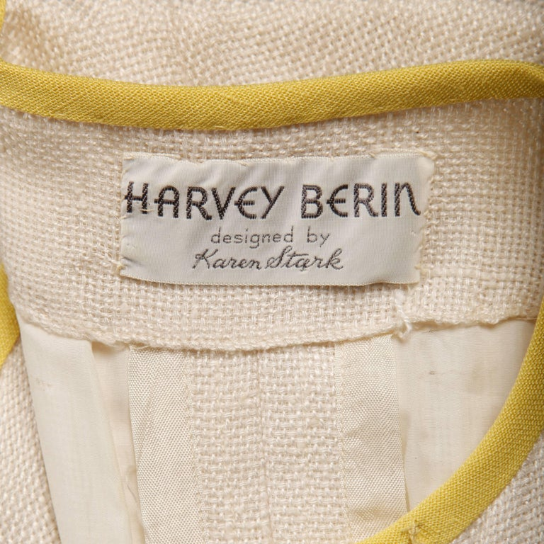 Beautifully done white linen dress with yellow trim by Karen Stark for Harvey Berin. Fully lined with front button, hook and snap closure. Front faux pockets. The marked size is 8, but the dress fits like a modern size small. The bust measures