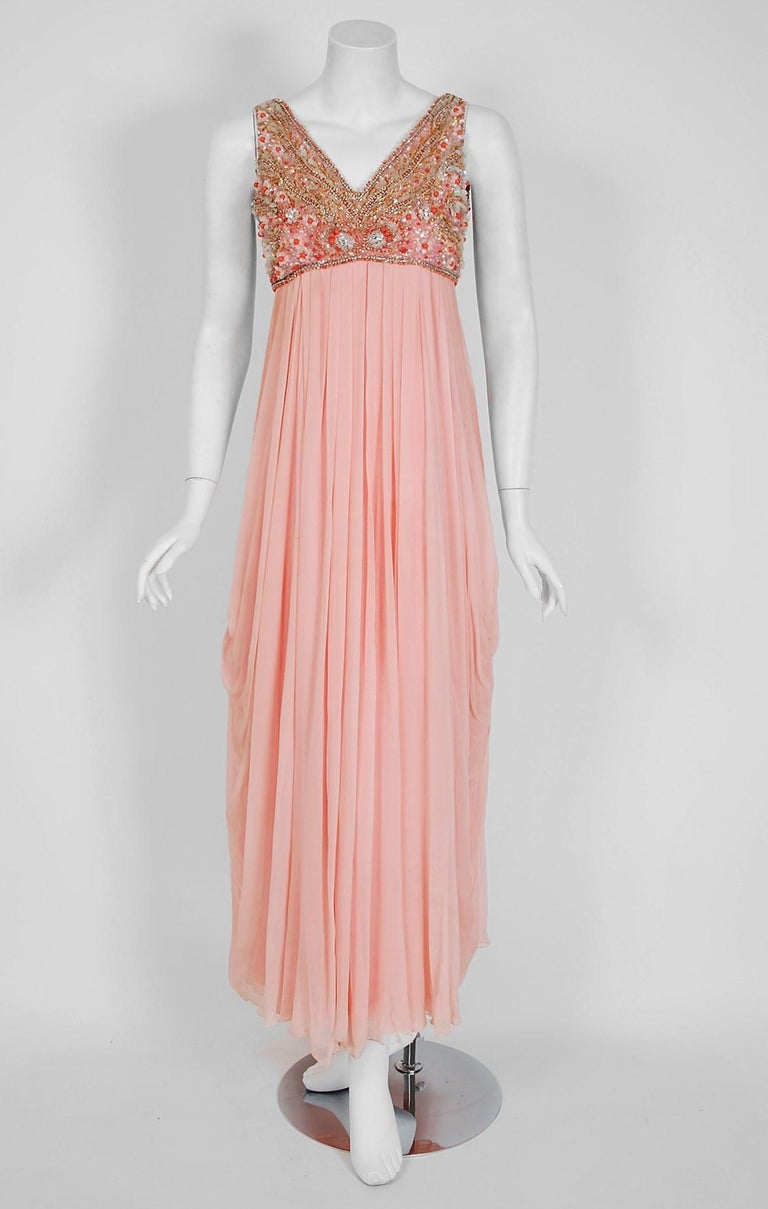 Helen Rose, like Edith Head and Irene Lentz, was one of the rare women who became chief costume designer for a major film studio. Her style was elegant and understated but still extremely innovative. This breathtaking light-pink silk chiffon goddess