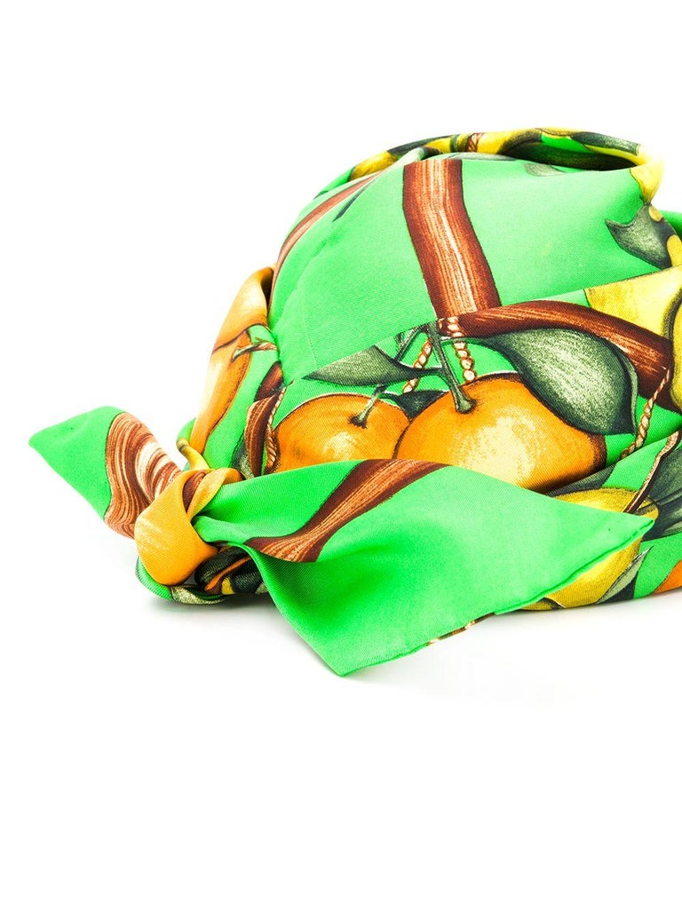 1960s Hermes green silk turban featuring a fruit print. 100% silk. Estimated size S   In good vintage condition. Made in France. We guarantee you will receive this  iconic item as described and showed on photos. (please enlarge images to see all