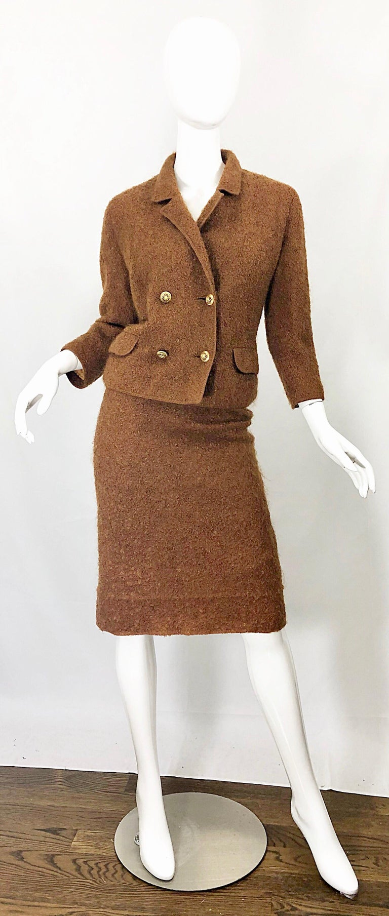 Incredibly chic vintage early 1960s I. MAGNIN tobacco rust brown mohair skirt suit! Features a soft wool mohair that is fully lined in a nude silk chiffon. Double breasted fitted blazer with a high waisted pencil skirt. Jacket features four gold