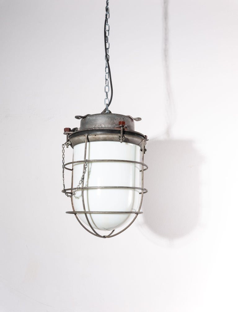 1960s vintage original industrial ships ceiling pendant lamps/lights with caged opalescent glass. We have three of these stunning ships lamps available. Made from cast and pressed aluminium each with their own weathered and heavily patinated