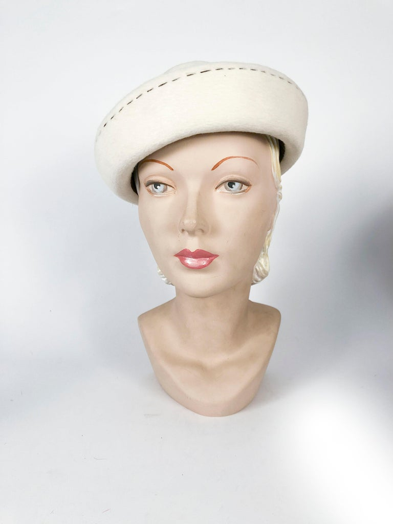 1960s Irene of New York cream colored sculpted fur felt hat with contrasting brown topstitching. The fur felt is very soft and a high quality felt made in France.