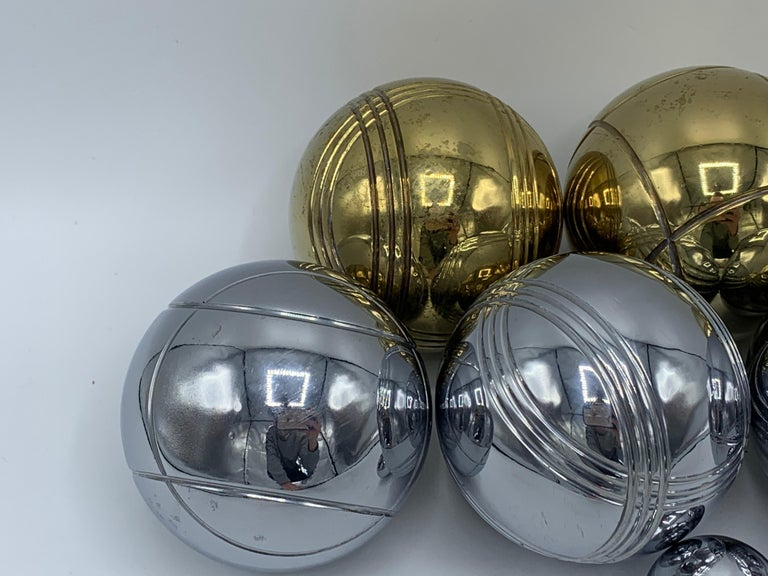 Listed is a stunning, 1960's Italian brass and chrome bocce ball set. Set includes four brass ball, four chrome ball, and one chrome pallino ball. Extremely heavy, with the whole set weighing 13lbs.