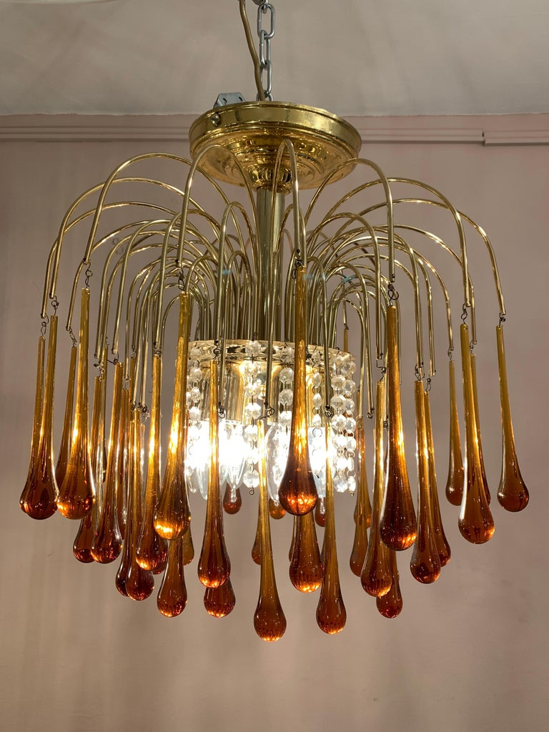 Vintage 1960s Italian Murano, amber-glass, cascading, flushmount chandelier designed by Paolo Venini. There are three-tiers of amber glass teardrops suspended from brass waterfall stems.  Six E14 screw-in bulbs sit under the brass canopy at the