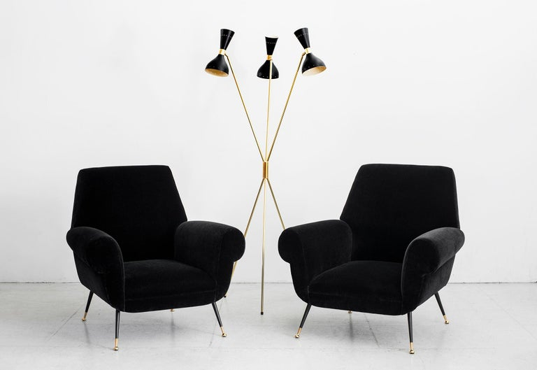 Gorgeous Italian 1960s club chairs in the style of Marco Zanuso newly upholstered in black mohair with polished brass legs. Fantastic large scale and shape.