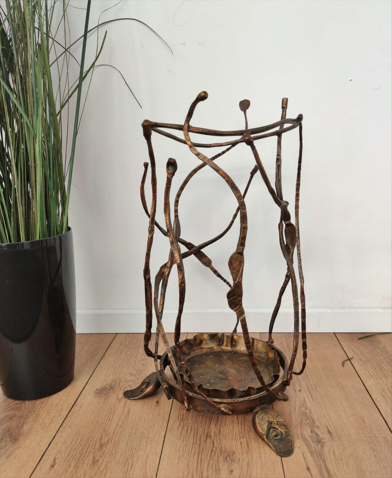 One of a kind Brutalist sculptural umbrella stand designed and handmade in wrought iron by the Italian artist Salvino Marsura, as signed on the bottom frame by the author.