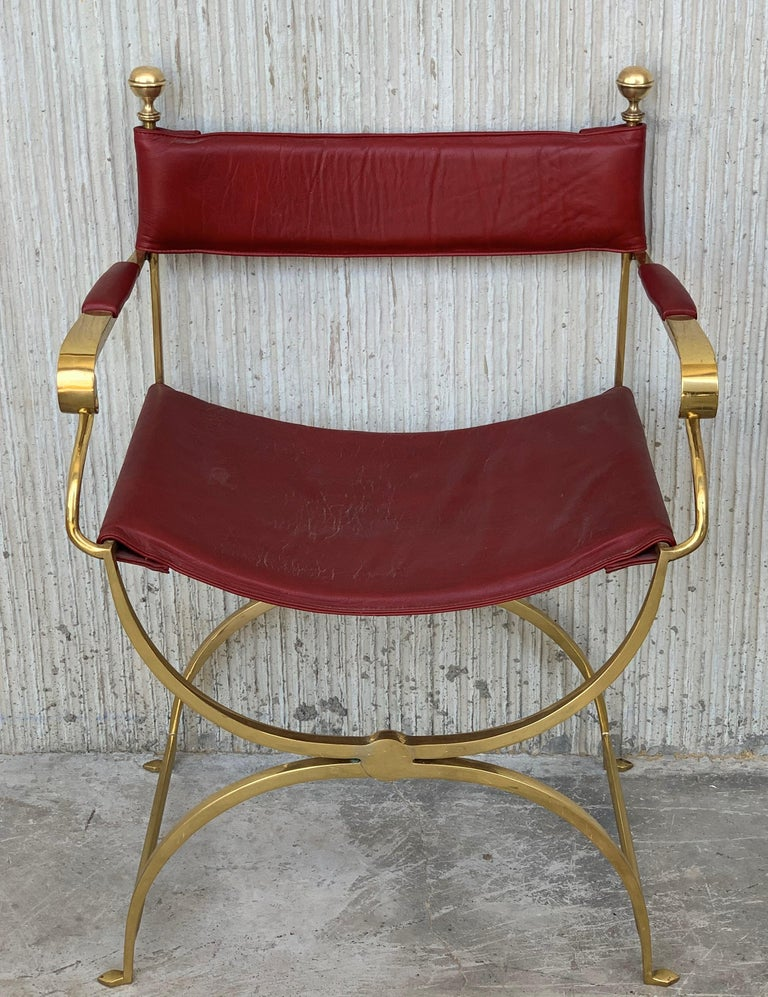 Pair of beautiful 1980s Italian chrome gold and red leather Savonarola director's chair in perfect conditions, with very minor fading and great timeless patina. Very comfortable armchair, quilted in back and seat. Size: Height to the arm
