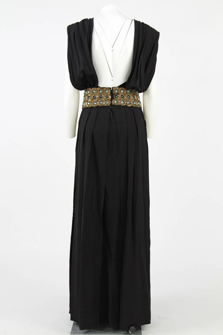 Beautiful and elegant 1960s Italian long dress, featuring a low back and a sequined belt. This piece is in very good conditions. Size 46 IT.  Measurements: length: 140 cm (approx) waist: 40 cm