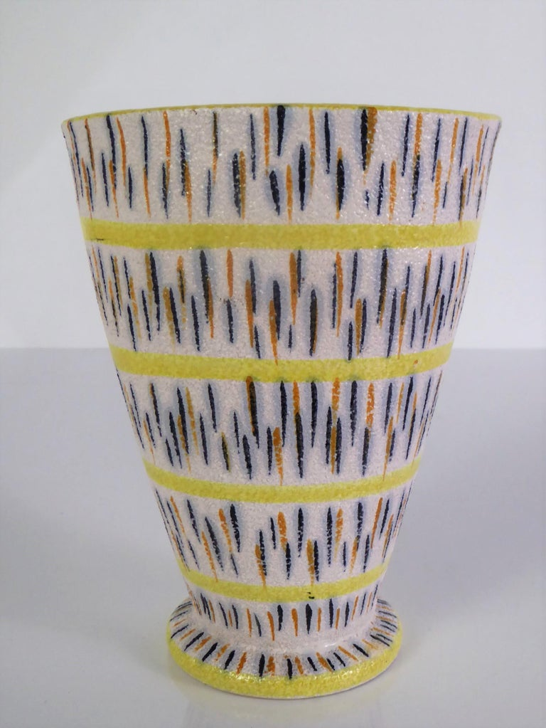 Lovely and cheerful Italian Modern pottery vase from the 1960s attributed to the master ceramicist Aldo Londi for the Bitossi company of Montelupo Italy.