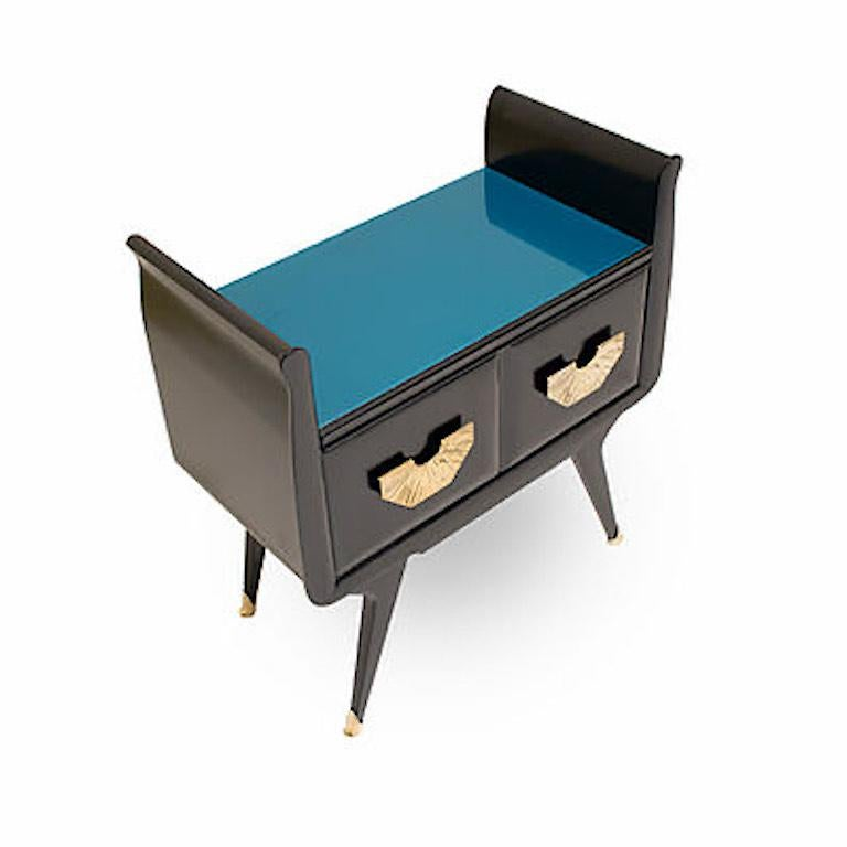 Pair of Italian vintage side tables, entirely handmade in Italy, ideal as bedside in a bedroom or next to a sofa for their functionality with a glass surface in a sophisticated teal blue color. High quality of construction with a black lacquered