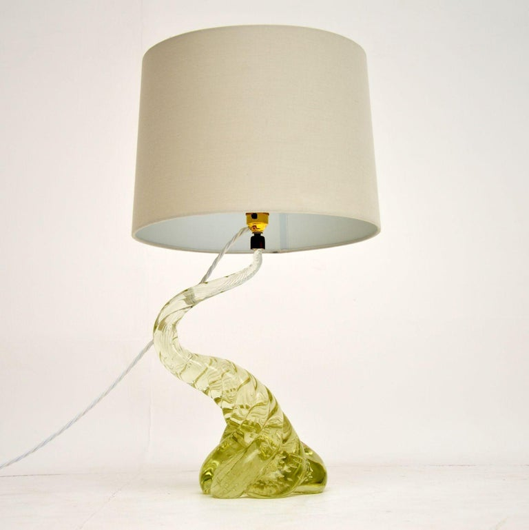 A beautiful vintage table lamp, made in Murano, Italy. This dates from the 1960s-1970s, it has a beautiful design and color, it is extremely well made. The blown glass has a green / yellow tone, it is solid and very heavy for its size. We have had