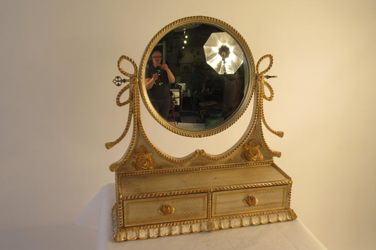 1960s Italian silver and gold painted vanity mirror. This item can be shipped UPS.
