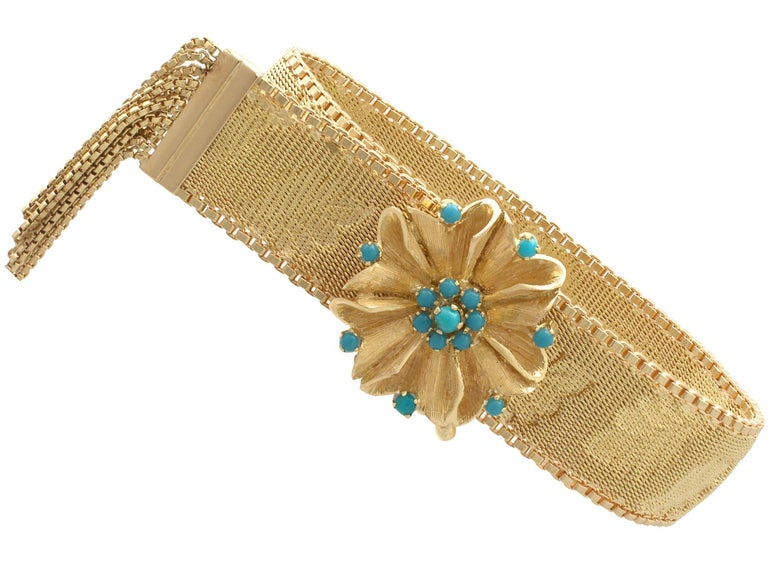 An impressive vintage Italian turquoise and 18k yellow gold adjustable milanese loop bracelet; part of our diverse vintage jewelry and estate jewelry collections  This fine and impressive vintage turquoise bracelet has been crafted in 18k yellow