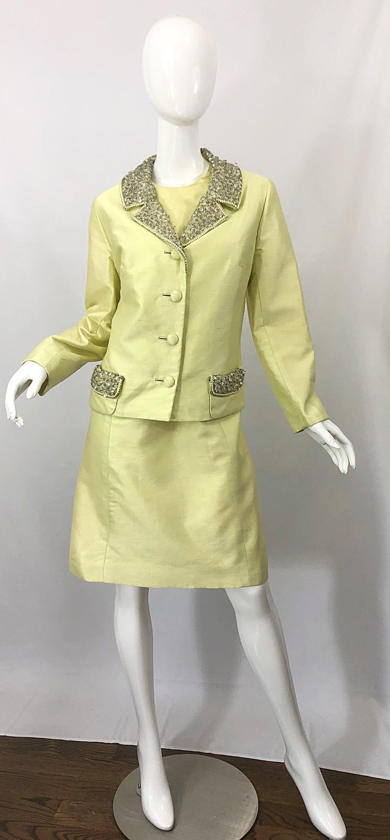 Chic vintage 1960s JACK BRYAN yellow silk shantung A-Line dress and jacket ensemble! Dress features a tailored bodice with a forgiving A-Line shape skirt. Full metal zipper up the back with hook-and-eye closure. Matching jacket has hundreds of