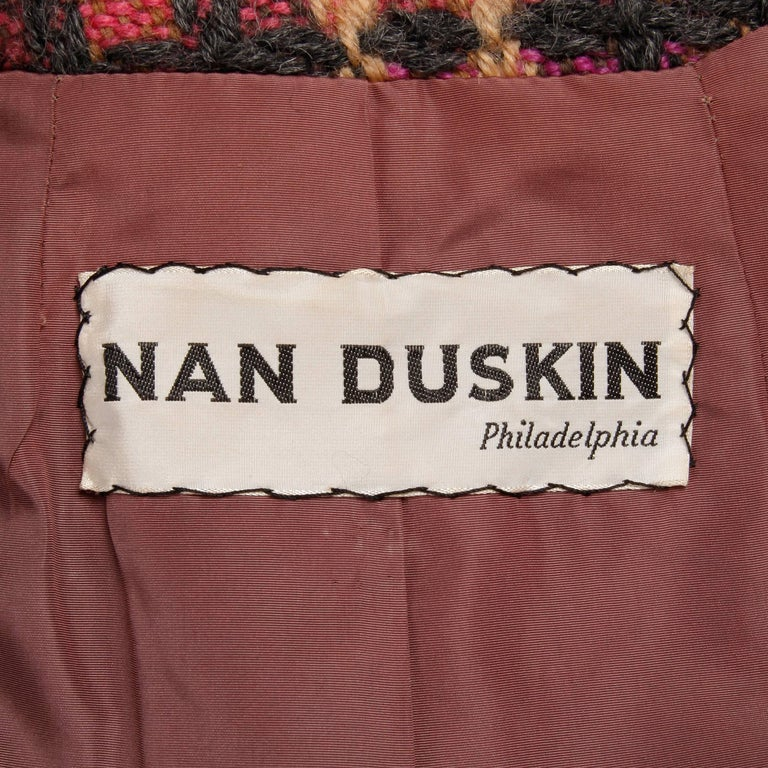 Gorgeous vintage 1960s pink plaid wool coat by Jack Feit for Nan Duskin. Fully lined with front button closure. Hidden side pockets. Fits like a modern size small. The bust measures 39