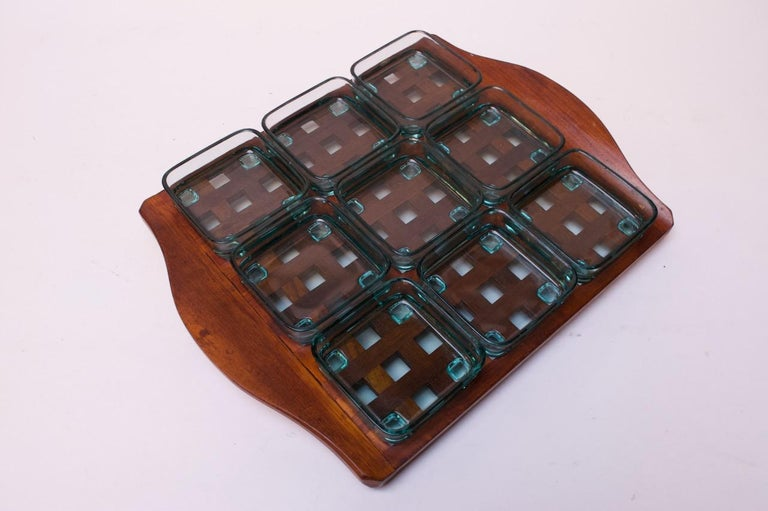 Danish 1960s Jens Quistgaard teak lattice serving tray with green, tempered glass inserts. Each glass dish has feet, which fit perfectly into the grid. The set is in excellent, vintage condition with only minor wear to the tray. Glass inserts are