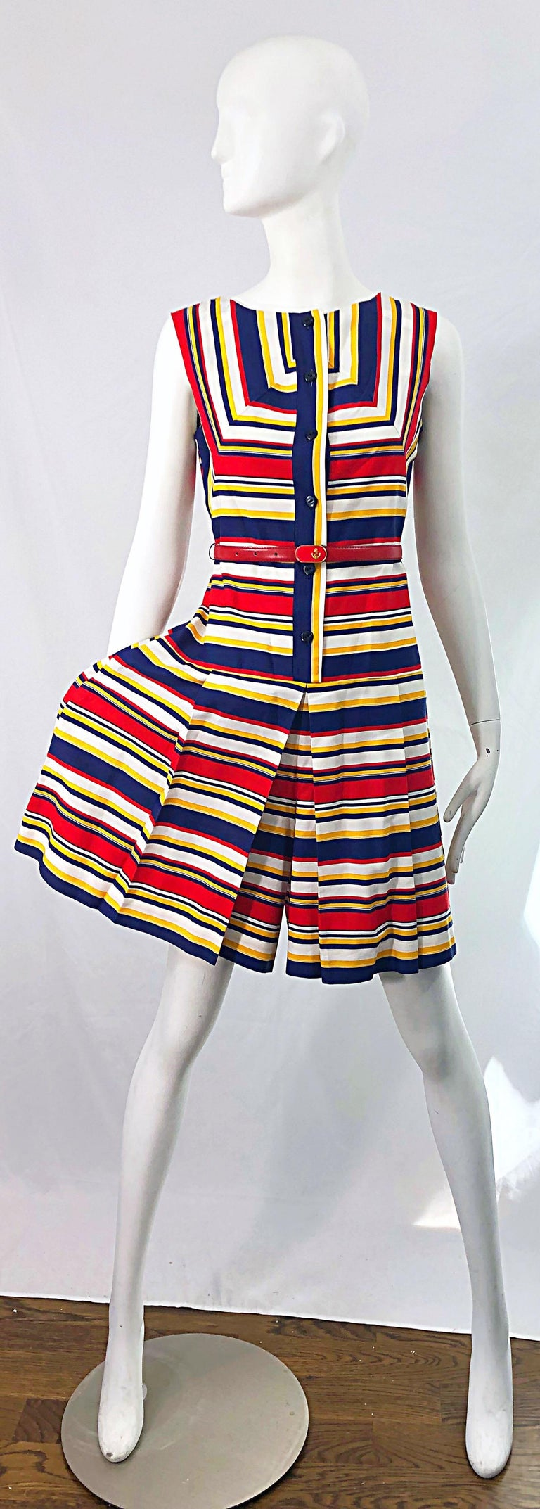 Chic 1960s JOAN CURTIS nautical belted cotton romper ! I thought this was a dress when I initially purchased this, but was pleasantly surprised when I went to photograph it, and realized that it was a romper! Features navy blue, red, yellow and