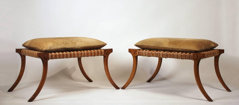Large-scale pair of 1960s vintage Klismos stools wrapped in cording with hair on hide cushions. In the style of T.H. Robsjohn-Gibbings for Saridis of Athens. 