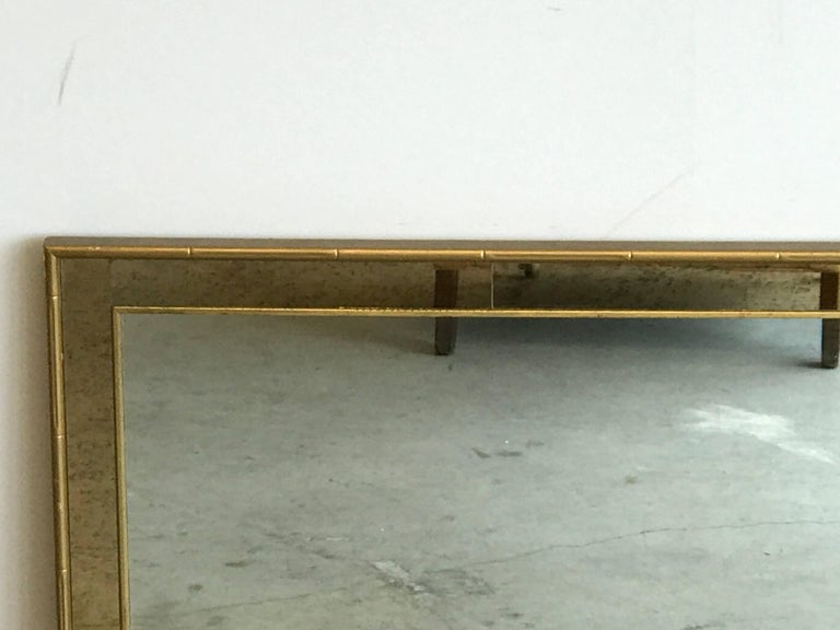Offered is a stunning, 1960s Labarge faux bamboo gilt mirror with mercury glass styled border. The piece can be hung horizontally or vertically. Marked on backside, see last photo. Heavy.