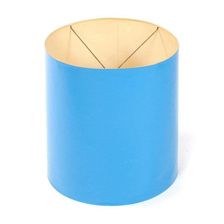 A vibrant, blue lacquered drum shade.