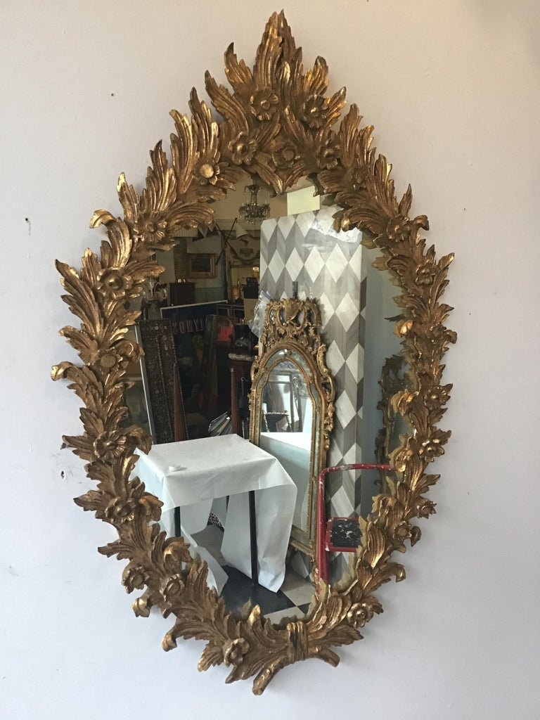 1960s large carved giltwood Italian mirror. This item has a matching mirror to it, the reference number is LU 107825271163. It's slightly different since it's hand carved.