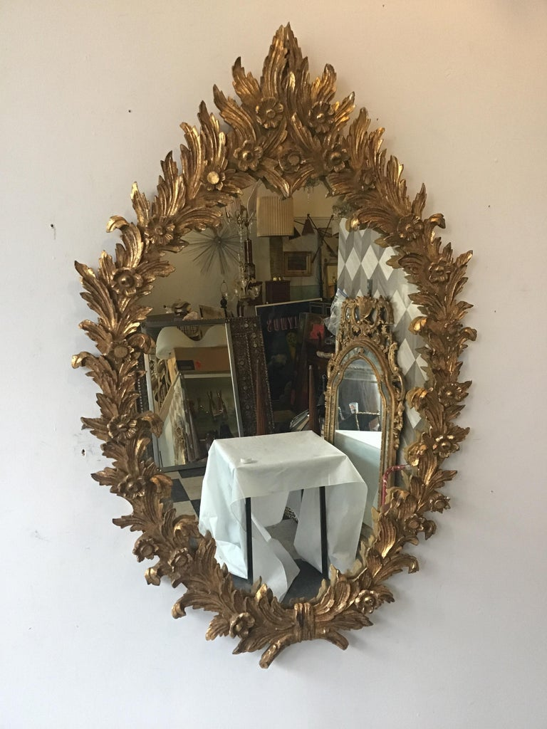 1960s Large Carved Giltwood Italian Floral Mirror ( Pair Available) In Good Condition For Sale In Tarrytown, NY