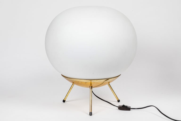 Large 1950s glass and brass tripod floor or table lamp attributed to Stilnovo. A quintessentially 1960s Italian design executed in opaline glass and brass. A sculptural and refined design characteristic of midcentury Italian design at its highest