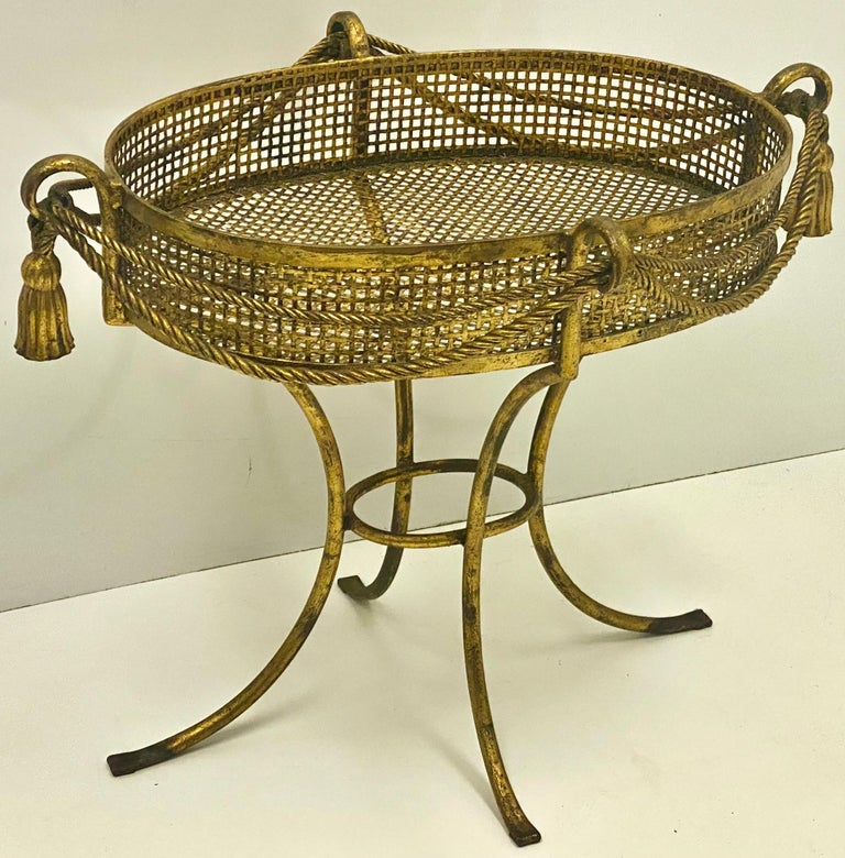 This is a large scale Italian Hollywood Regency gilt tassel planter. This is a fun piece as we approach spring. It is all original with age appropriate wear.