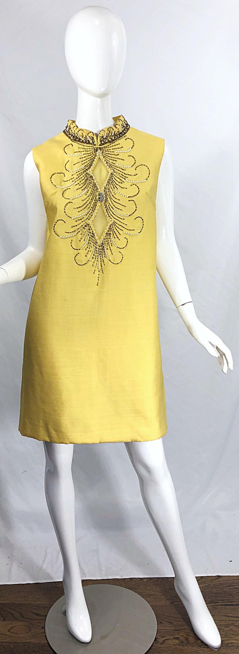 Chic early 60s larger sized yellow beaded, rhinestone and sequin silk shantung shift dress ! Features hundreds of hand sewn beads throughout. Semi sheer diamond shaped mesh cut-outs at the bust. Hidden metal zipper up the back with hook-and-eye