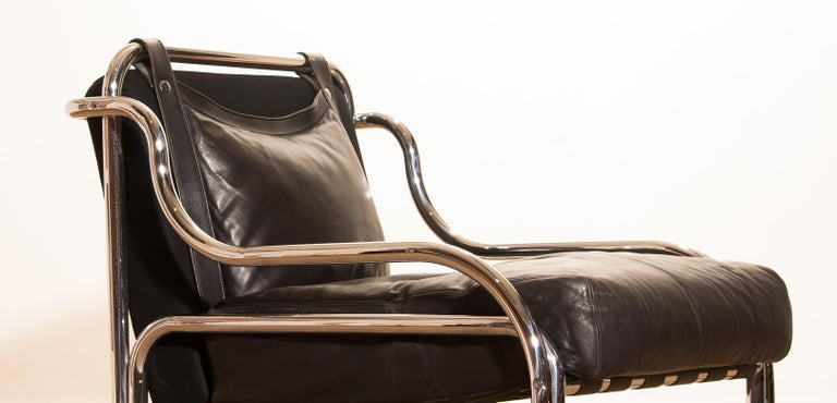 Wonderful lounge set designed by Gae Aulenti for Poltronova Italy. This beautiful set consists of a sofa and chair made of a black leather seating on a chromed frame. It is in an excellent condition. Period 1960s Dimensions sofa H.73 cm, W.130