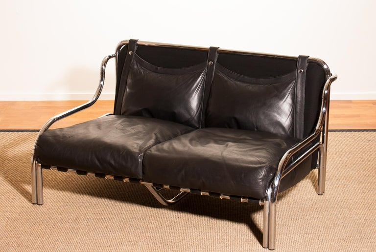 Wonderful lounge sofa designed by Gae Aulenti for Poltronova Italy. This beautiful sofa is made of a black leather seating on a chromed frame. It is in an excellent condition. Period 1960s. Dimensions: H 73 cm, W 130 cm, D 80 cm, SH 30 cm.