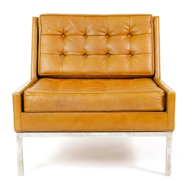 Dunbar leather lounge chair its frame having slightly raised sides as well a slight 'wing' effect to the back together forming channels which the button tufted seat and back cushions fit in to allowing the cushions to sit flush with the sides and