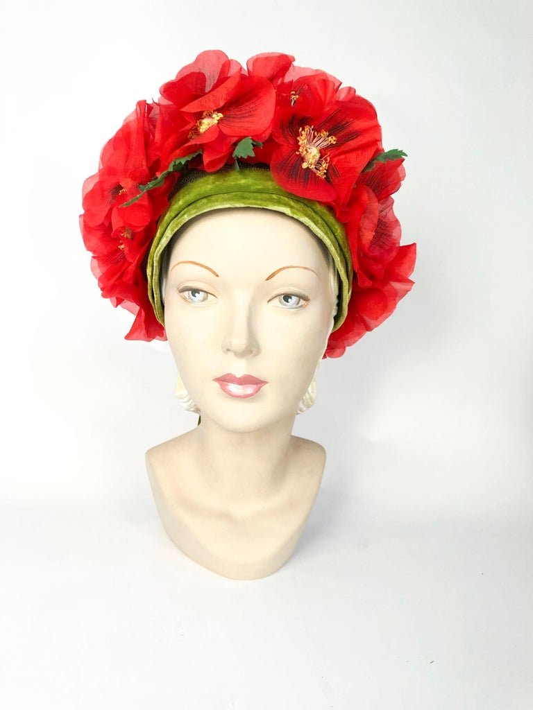 1960s Leslie James High-Fashion Floral Hat with hand cut and hand painted flowers and finished with a green velvet bow and band.
