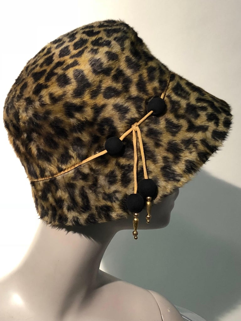 1960s Leslie James leopard print faux fur bucket-style hat W/ unique beaded band of cord, jersey covered and gold beads.