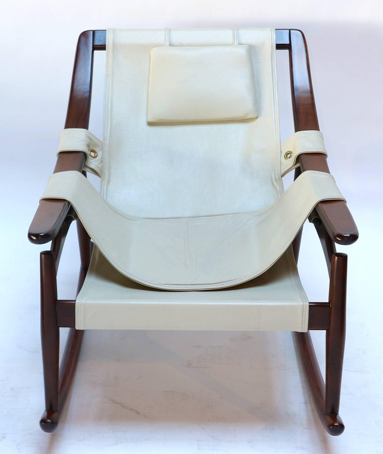 1960s Brazilian jacaranda wood rocking chair upholstered in beige leather by Liceu de Artes e Ofícios, Sao Paulo, Brazil.