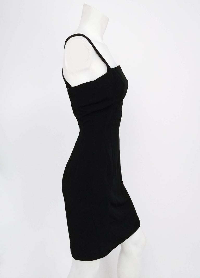 009394f60ad81 1960s Lilli Ann Black Crossback Cocktail Dress. Square neckline with  crossed back strap detail.