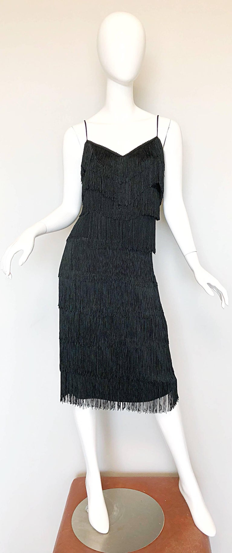 Fabulous mid 1970s does 1920s LILLI DIAMOND black fully fringed flapper style jersey cocktail dress! Words cannot even begin to describe how utterly gorgeous and flattering this dress is in person! Layers and layers of fringe look fantastic with