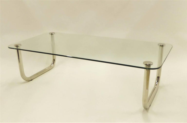 Great scale and fat tubular legs in the style of John Mascheroni with curving nickelled sled legs highlight this rarely seen late 1960s coffee cocktail table with a floating 1/2 inch glass top. Legs re-nickelled, new glass. Fabulous