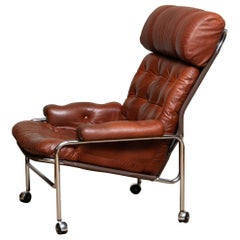 1960s Lounge / Easy Chair in Chrome and Aged Brown Cognac Leather by Lindlöfs 1