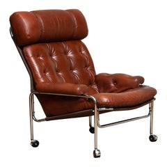 1960s Lounge / Easy Chair in Chrome and Aged Brown / Cognac Leather by Lindlöfs