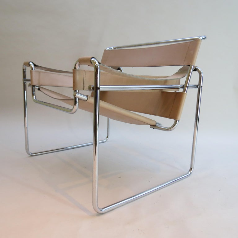 A Wassily chair designed by Marcel Breuer and manufactured by Gavina, Italy. This chair dates from 1968–1972, original year of design 1925. Polished chrome tube with cream leather seat and arms. In good overall condition, some wear to the leather