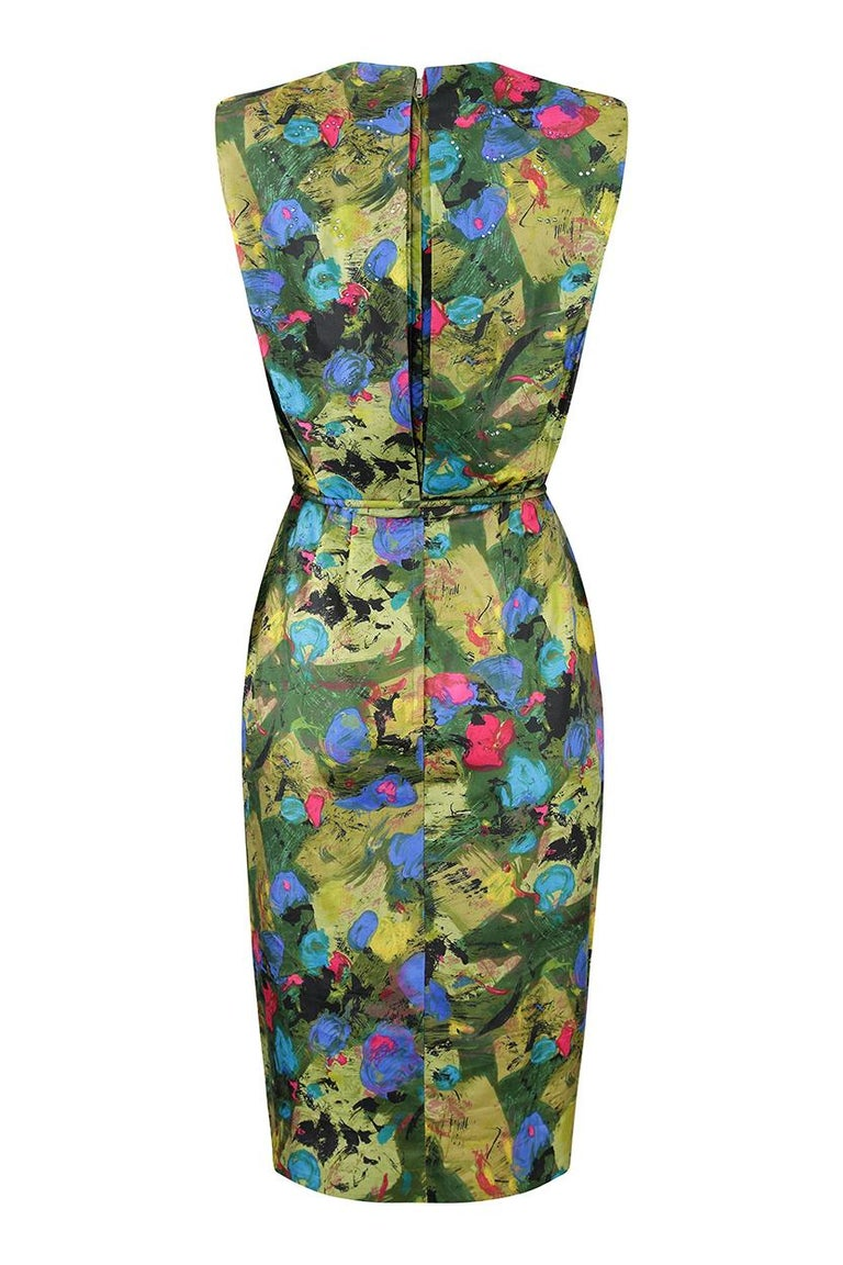 This fabulous 1960s silk cocktail dress with matching belt tie is by Mardi Gras of New York and is in impeccable vintage condition. The printed silk fabric has an abstract paint effect design in vibrant fuchsia, turquoise and cobalt blue over moss