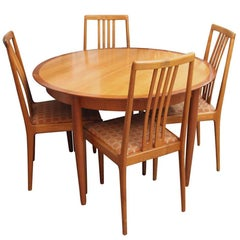 1960s mid century modern extendable round table set with five chairs - Antique Dining Room Sets