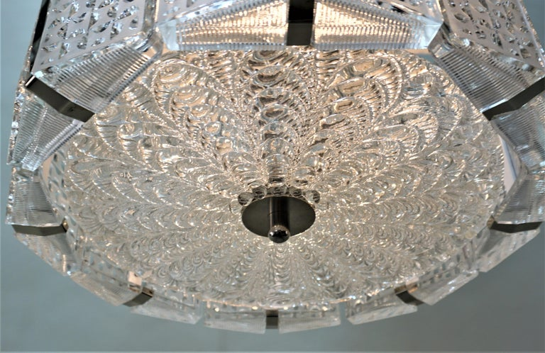 Eight texture clear glass side panels as well as center texture glass with nickel/chrome hardware chandelier.