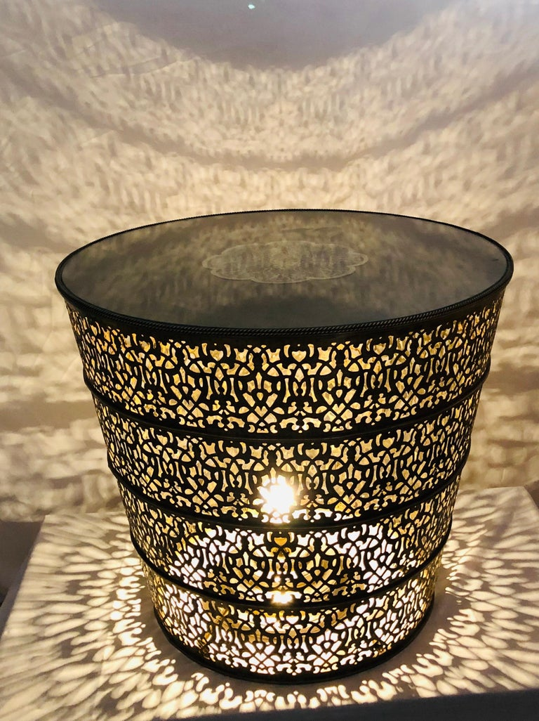 A majestic all brass round center table, lamp table or side table. The handmade 1960s Moorish style table features amazing intricate design. Three bulbs can be wired from inside the table, turning it into a lighted table.