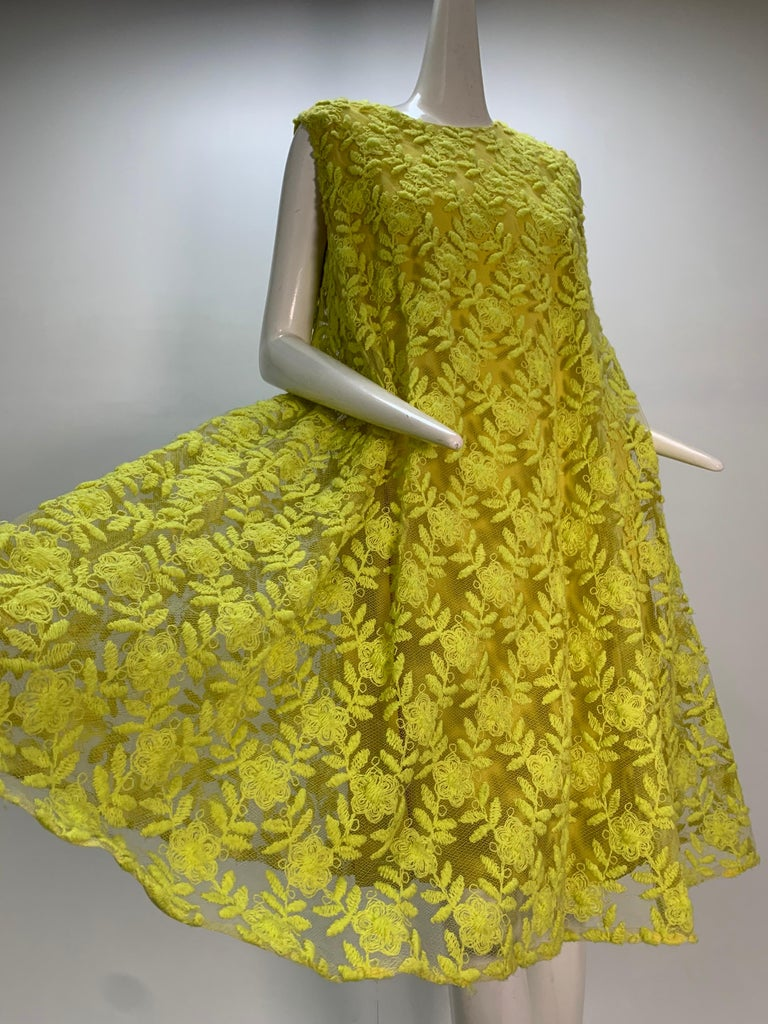 A fabulous Mod 1960s Mr. Blackwell neon yellow wide A-line swing dress: yarn-embroidered tulle layed over crepe under-dress.