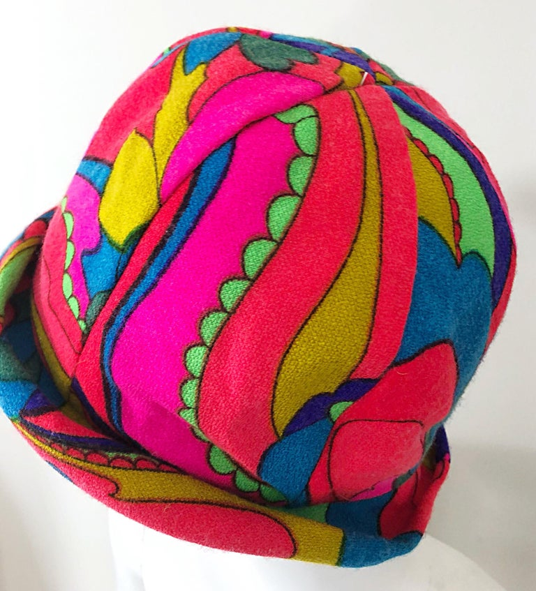 This 1960s MR. MARTIN cloche hat is the epitome of the 60s! Vibrant colors of hot pink, blue, green, orange, and yellow throughout. Soft lightweight virgin wool is perfect for any time of year, and is lined. Great with jeans, or a dress. In great