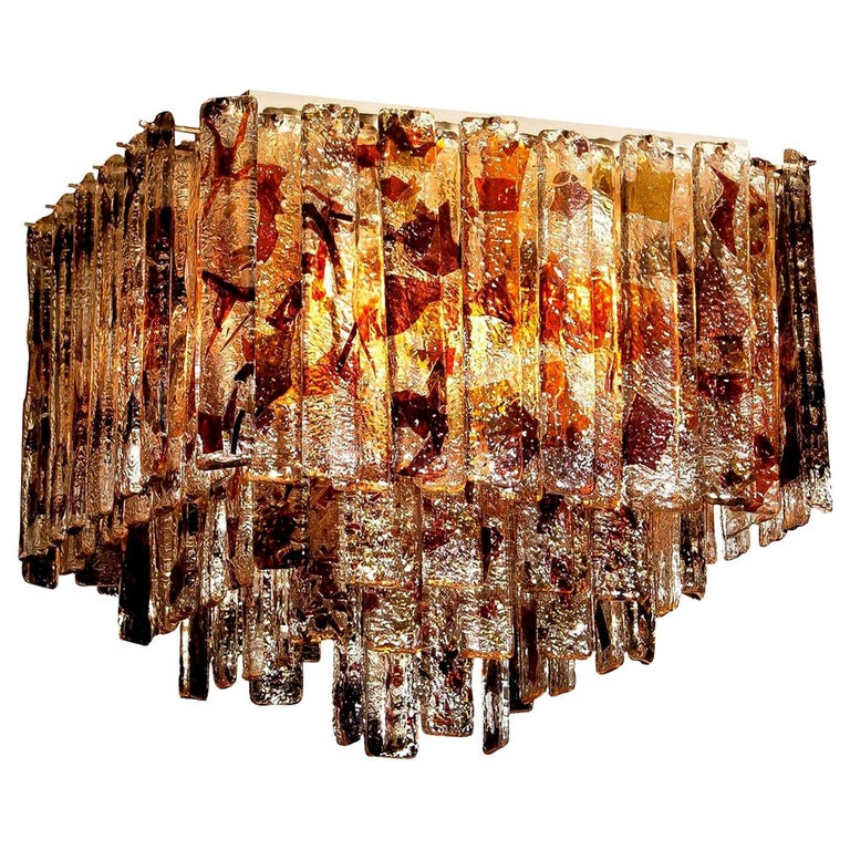Stunning Italian Mid-Century Modern squared ceiling lamp by Mazzega. 95 pieces of clear crystal elements measuring 28 cm each. The glass hangs on hooks and pins on to a white lacquered metal frame, as pictured. The elements have three colors