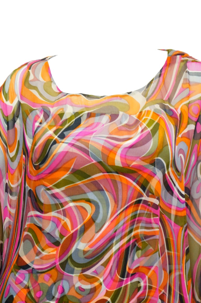 Amazing two layer dress with brilliant pink, green, cream, and blue swirling pattern! This dress features a somewhat fitted silk dress with wide round neckline, wide straps, a slightly contoured waist, and a maxi length skirt. The top layer of the